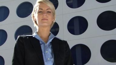 Portrait of female slowly turning her head towards camera