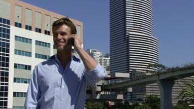 Male on bridge talking on mobile phone