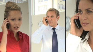 Montage of business people in office on the phone