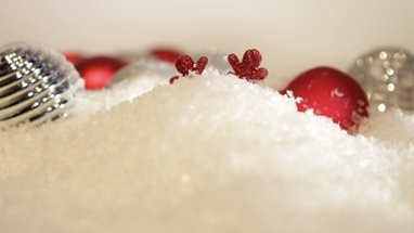 Close up of christmas decoration covered in snow