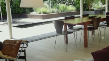 WS, Track,view on living room and garden in contemporary house, UK