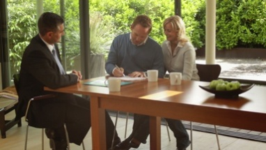 Wide, Track shot off couple signing contract at dinning table and handshake financial advisor