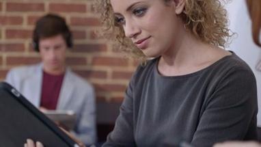 CU TU Woman using digital tablet in coffee shop / London, Greater London, United Kingdom.