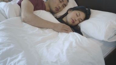 MS TU Couple sleeping on bed in bedroom