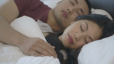 CU PAN Couple sleeping on bed in bedroom
