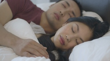 CU R/F Couple sleeping on bed in bedroom