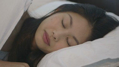CU PAN Young woman sleeping on bed in bedroom