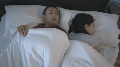 MS Couple sleeping on bed in bedroom