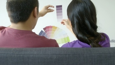 MS Young couple choosing Colour Swatch in living room