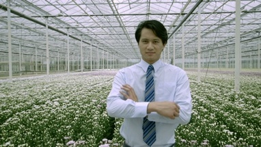 MS Portrait of businessman standing in greenhouse