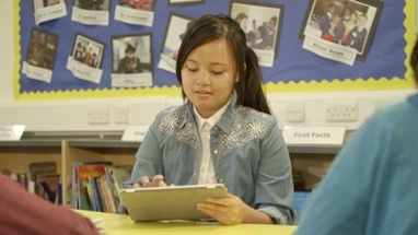MS Schoolgirl using tablet in library