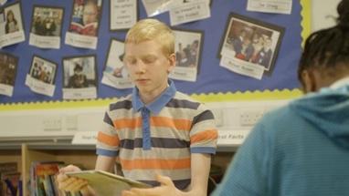 MS TU Schoolboy using tablet in library