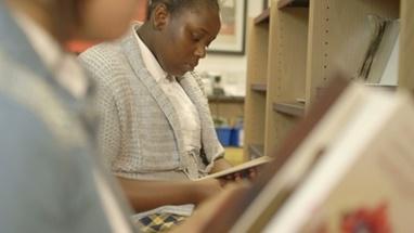 CU TU Schoolgirl reading book in library
