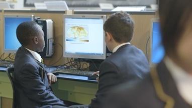 MS R/F School children using computer in computer laboratory