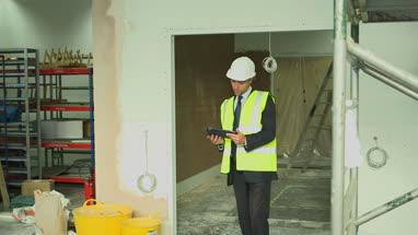 Man using digital tablet at construction site