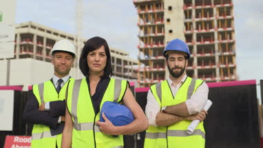Architect confidently looking at camera at construction site