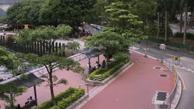 View of pavement and land vehicle passing through street at Victoria Park, Hong Kong, China