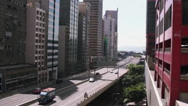 View of city with modern buildings and land vehicle moving on bridge at Hong Kong, China