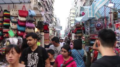 View of Fa Yuen Street Market while young woman taking photo with camera at Hong Kong, China