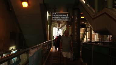 Commuters walking through subway in Hong Kong, China