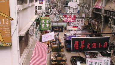 View of city with banners and sign board in Hong Kong, China