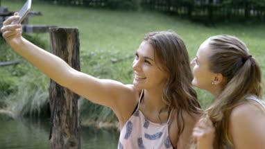 Friends taking selfie in countryside