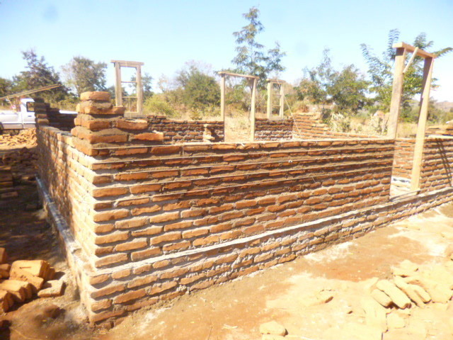 Atupele's new house being built in Malawi