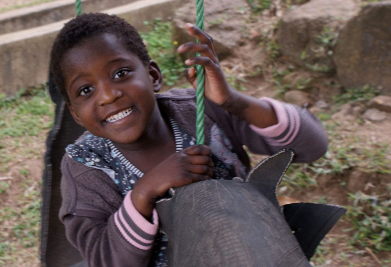 2010-Kandichere-plays-on-the-swing-at-her-foster-home-web.jpg