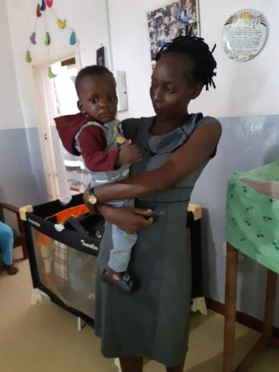 Baby blessing with foster mother in Malawi