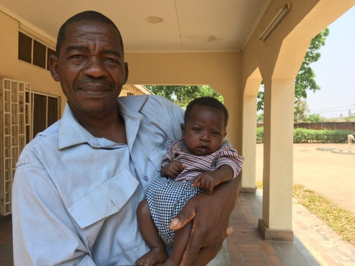 child and father in malawi