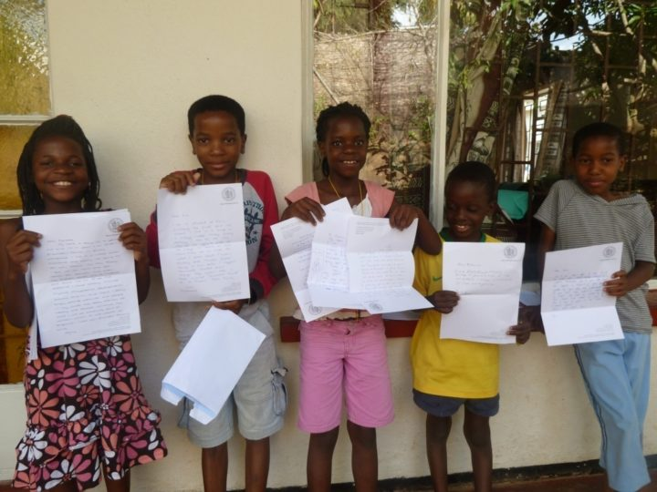 Sekwe-kids-with-letters-from-QES.jpg