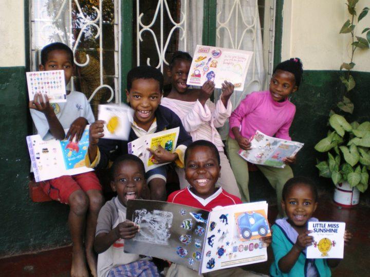 sam-eric-sekwe-kids-with-QES-cards.JPG