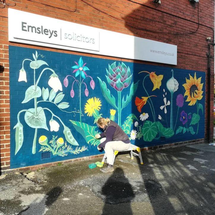Edible plant powered mural in progress.