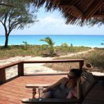 Relax on the deck at Vamizi Island Lodge