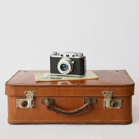 A suitcase and camera for travelling