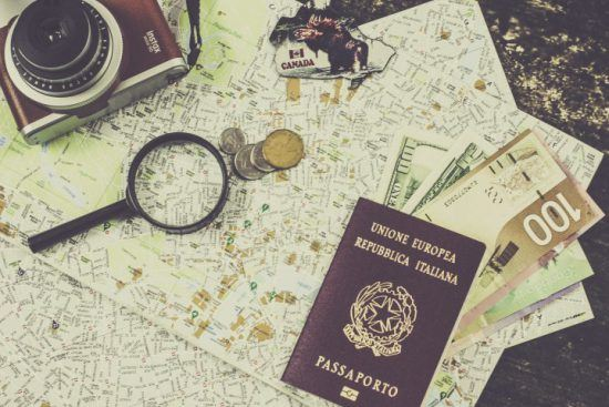 A passport, map, money and camera