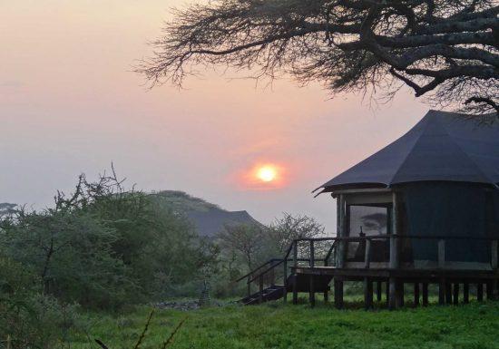 A beautiful African sunrise at our tented camp. - Lake Masek.