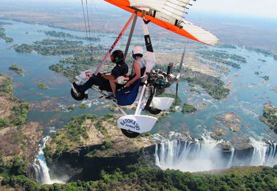 Tourists Microlighting over Victoria falls
