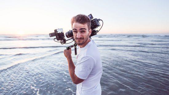 Cameraman hard at work on the beach