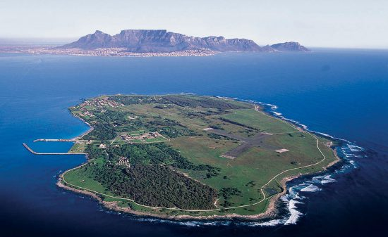 Aerial view of Robben Island with Cape Town in the background