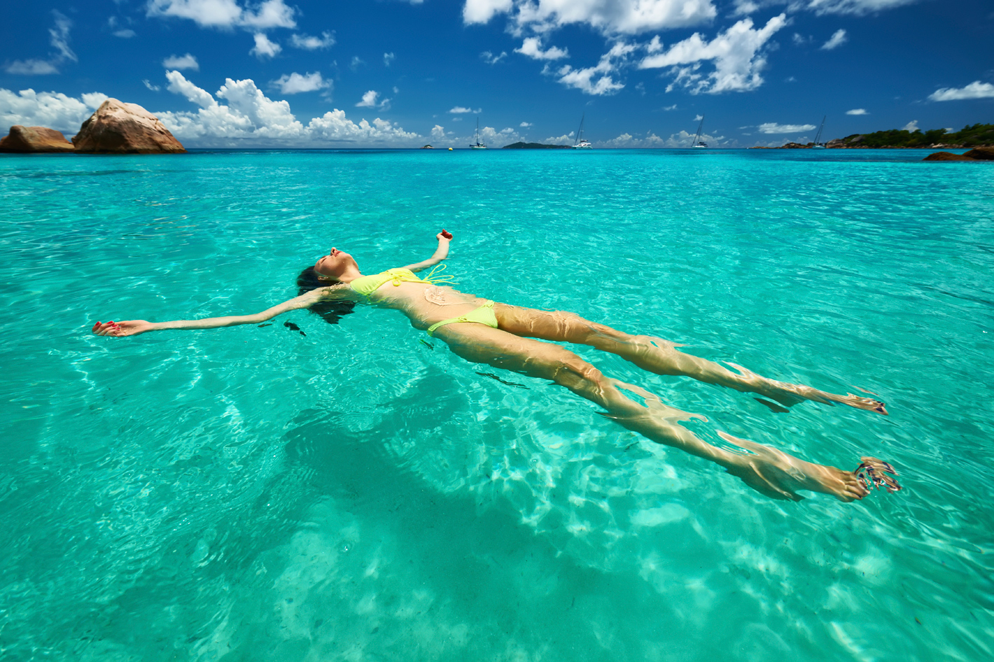 Girl floating in water in Indian Ocean