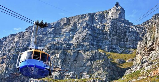 A cable car makes it way to the top of Table Mountain