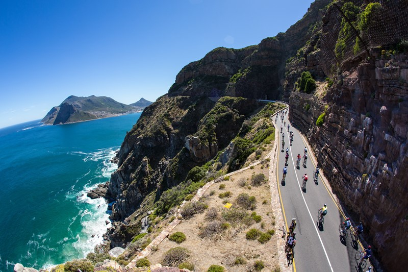 CAPE TOWN, SOUTH AFRICA - MARCH 10, Cyclists ride up Chapmans Peak during the Cape Argus Pick n Pay Cycle Tour 2013 on March 10, 2013 in Cape Town, South Africa