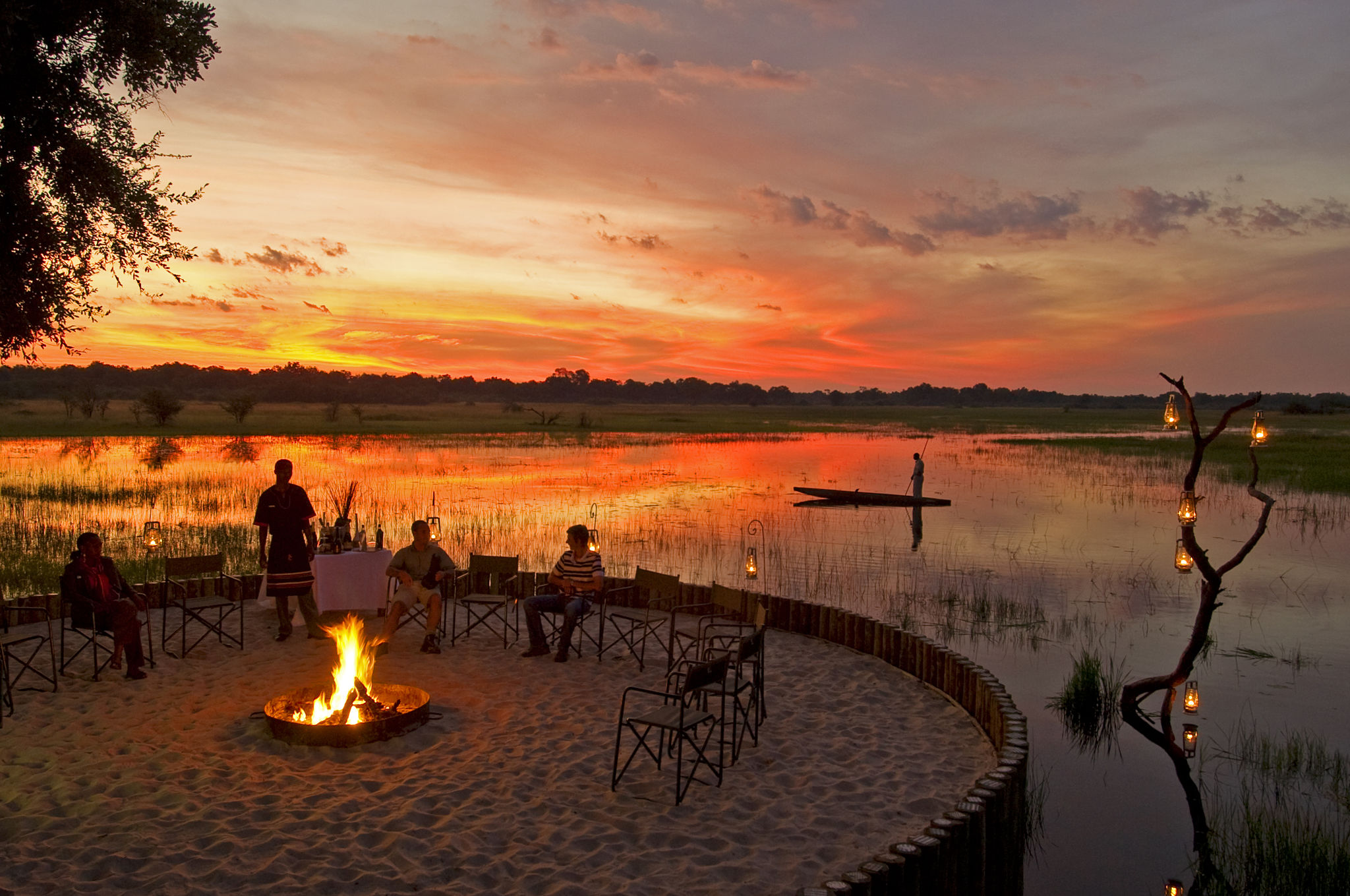 a waterside fire and sunset view