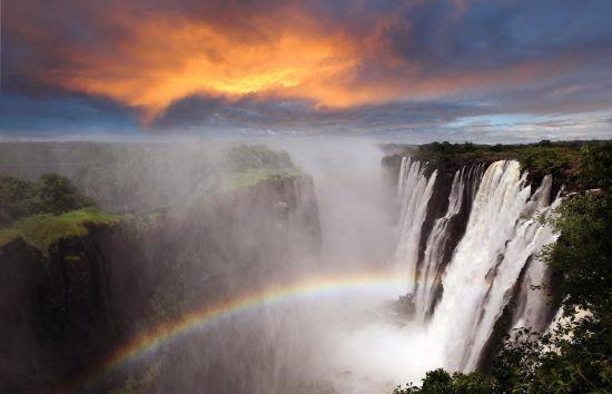A rainbow shown in the midst of the falls