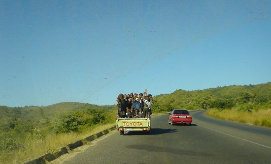 Kids on the back of a truck bakkie