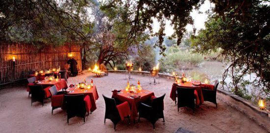 Boma dinner at sunset wwith candles lit