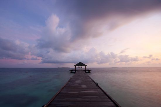 Jetty in the Maldives at sunset Island Holidays
