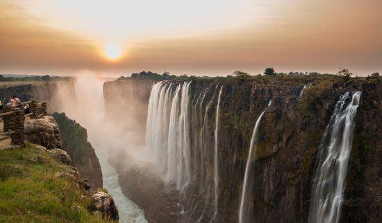 Sun sets behind Victoria Falls