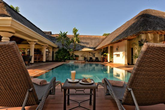 Enjoy poolside drinks in Victoria Falls